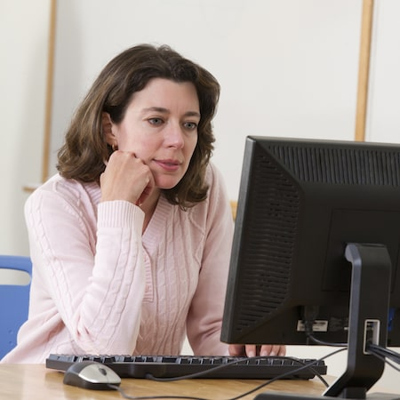Shot of a woman with a computer in front